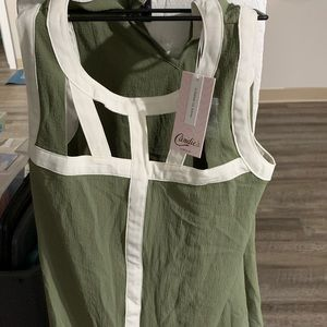 Green and white flowing top with keyholes.